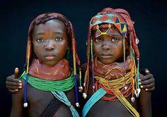 Mwila tribe girls in Angola.  Via @ericlafforgue ------ #Osengwa | #AfricanArt | #AfricanFashion | #AfricanMusic | #AfricanStyle | #AfricanPhotography | #Afrocentric | #Melanin | #African | #Art | #AfricanInspired | #InspiredByAfrica | #BlackIsBeautiful | #ContemporaryArt | #OutOfAfrica