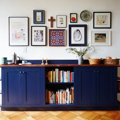 Narrow upper cabinets used to create a slim sideboard...and navy blue...love it!