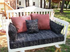 Swing made from a baby crib. Hate the fabric choices, but love the rest