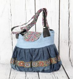 DIY recycled jeans hand bag. This is fun and funky pumpkin shaped bag, embellish with decorative beaded tape. Patterns at www.izzymeimsaab.com