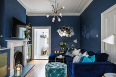 [New] The 10 Best Home Decor (with Pictures) - Bright white brings the (moon)light to midnight-blue rooms. Silver linings come in the form of metallic cushions reflective hexagons mirror-fronted cupboards and glass lanterns and table tops. Navy Living Rooms, Dark Blue Living Room, Dark Blue Walls, Blue Living Room Decor, Glam Living Room, Eclectic Living Room, Living Room Colors, New Living Room, Living Room Interior