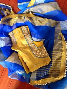kundan studded golden coloured blouse with plain blue silk saree. Saree Blouse Patterns, Saree Blouse Designs, Blouse Styles, Blue Silk Saree, Yellow Saree, Yellow Blouse, Indian Blouse, Indian Sarees, Indian Wear