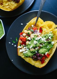 This healthy spaghetti squash recipe features your favorite Mediterranean ingredients, including pesto! It's a great fall dinner. http://cookieandkate.com