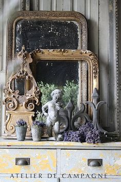 Vintage French Soul ~  Atelier de Campagne. Layers of beautiful antique mirrors and empty frames is a sublime statement.