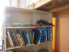 the bookcase opens to reveal the secret room.