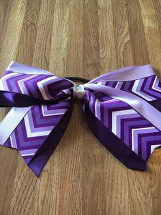 A personal favorite from my Etsy shop https://www.etsy.com/listing/267086739/purple-chevron-cheer-bow