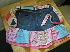 So cute and easy. Make an apron using the back of an old pair of your {husband's} jeans, fabric through the belt loops and a ruffle on the bottom. Super cute.