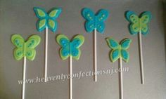 Blue and green white chocolate butterfly lollipops