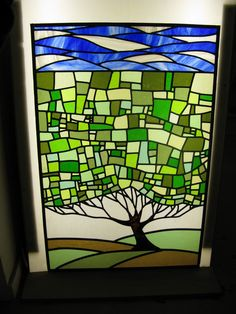 The tree design is one I have seen attributed to Allen Kenoyer Glass, and is one that I have admired for years.