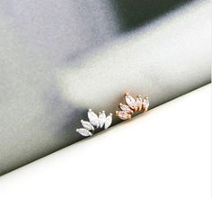 This listing is for one crown stud earring that measures 8mm x 4mm. Dainty and unique, these earrings will be a cute little statement to your