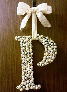 Gift a personalized Letter 'Wreath' made by gluing Christmas berries from the craft store to a wood letter. Also could work using buttons, pearls or rhinestones. Include a beautiful wide ribbon for hanging.