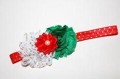 This is such a beautiful Christmas headband! It has shabby flowers in red, green, and white on a red with green polka dots headband. It would be