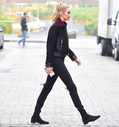 Bundled up: The 20-year-old showed off her svelte figure in the fitted ensemble, adding a ...