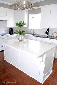 Exact layout for our Kitchen Remodel; light gray island and marble backsplash, brick floor, lantern light over island