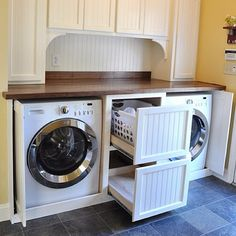 Laundry room idea  Love the drawer idea for the dirty laundry! We will have to do this! Not to mention the pocket doors that pull out from the sides to cover the front of the washer and dryer.  Yee hah