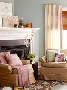 Well-chosen neutrals are also important when decorating with cozy colors. Mocha armchairs play in to this living room's inviting personality and temper the stark white trim and fireplace surround.
