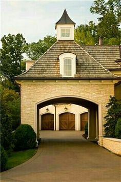 Pretty garage doors seen through the porte cochere. Porte Cochere_a covered entrance large enough for cars to pass through, typically opening into a courtyard Porte Cochere, Style At Home, Future House, My House, Gate House, House Doors, House Entrance, Driveway Entrance, Cottage House