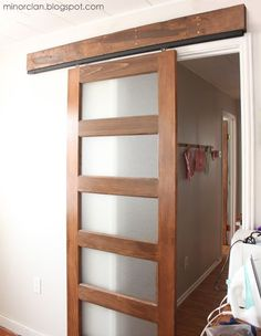 DIY Sliding Door | The Lettered Cottage - uses hardware for mirrored sliding closet doors, wood & stoppers on floor