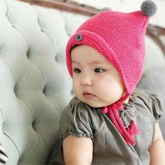 5488fbf0290 Knitted Pom-Pom Infant Hat. Baby Girl ...