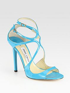 "Jimmy Choo Lance Patent Leather Sandals    Channel minimalist vibes in this signature silhouette of lustrous patent leather.  Lacquered heel, 4½"" (115mm)  Patent leather upper  Adjustable ankle straps  Leather lining and sole  Padded insole  Made in Italy"