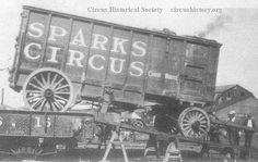 Sparks Circus wagon being unloaded from a railroad flatcar