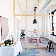 Use glass walls to separate spaces without visually dividing a room. | 31 Tiny House Hacks To Maximize Your Space