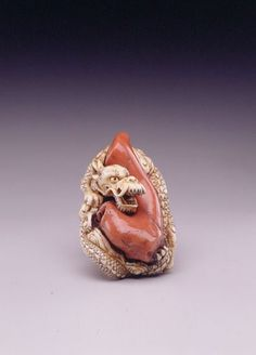 Genryosai,  Dragon with coral,   mid 19th century, ivory,  ht. 1 7/8 in. (4.7 cm)  The Toledo Museum of Art