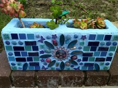 Cinder block mosaic planter. Great way to have an herb garden.