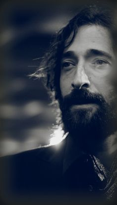 Adrien Brody - looks like a still from The Pianist