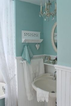 Chandelier above sink in half bath- I like this idea for the bathrooms!