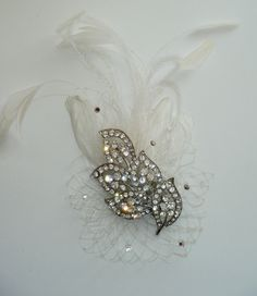 Fasinator with vintage-inspire crystal piece & feathers, it is FABULOUS. $45.00, via Etsy.