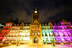 The Manchester Town Hall was illuminated in the colours of the rainbow to show solidarity with the LGBTQ community. Manchester Town Hall, George Michael, Rainbow Colors, Big Ben, Community, Colours, Explore, Night, Building