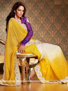 Charming yellow and off white shade saree embellished with bead and stones. Shimmering stones and beads studded cut work patch looks attractive and designer. Perfect selection for wedding function. http://goodbells.com/saree/charming-yellow-and-white-saree.html