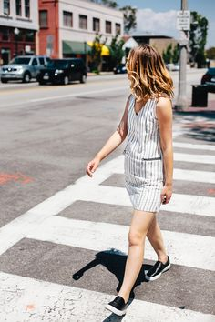 Dress down a dress with a pair of casual sneakers for your day time activities