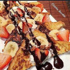 Banana Split French Toast By @karina_liberation Serves 1  French Toasts: 2 slices of grain bread  1 whole egg  1/8 cup unsweetened almond milk  1 teaspoon granulated sweetener or sub with raw sugar 1 teaspoon vanilla extract  Topping:  1/2 sliced Banana  4 sliced strawberries  2 tablespoons low fat vanilla greek yoghurt  10g semi sweet chocolate chips, melted  1 teaspoon (2g) crushed pecans/walnuts  Mix the egg, milk, sweetener and vanilla well. Dip bread (one at a time) into egg wash. Cook…