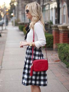 Red bag and midi skirt