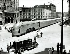 "Historic Photo from 1930's by Art Cornelius The New York Central streamliner ""Mercury"" pauses at Syracuse City Hall on it's way to Chicago June , 1936. Syracuse Newspapers file photo"