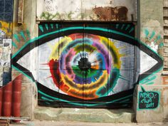Chilean street art by Nbio. Want to see it in person? Travel to Chile at almost no cost by working while you travel! Click on the image for details! #chile #southamerica #art #graffiti #eye #spraypaint #travel #backpacking #traveltips #color #peru #colombia #city #urban #create #beauty #experience @backpacking