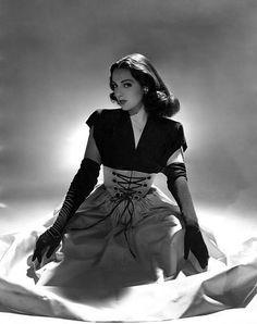 "loveinaromanticcity: ""  Linda Darnell in a corselet dress by Traina-Norell |  John Rawlings | Vogue | 1944 | via skorver1 on flickr.com """