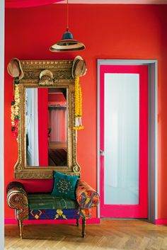 Matthew Williamson's home features in this month's Living Etc magazine with a full article entitled 'bohemian rhapsody'. Sun hats hanging from a golden framed mirror against a red wall in Matthew's home. Click to read more.