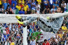 Italy's goalkeeper Gianluigi Buffon hangs on to the goal as he celebrates after the Euro 2016 group E football match between Italy and Sweden at the Stadium Municipal in Toulouse on June 17, 2016. .Italy won the match 1-0. / AFP / VINCENZO PINTO