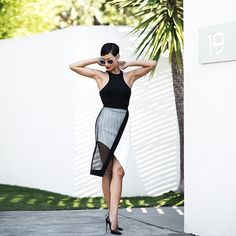 Micah wears the Pearl And Rubies mesh & satin wrap skirt from the SS16 collection.