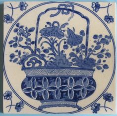 Lovely blue and white transfer printed tile with a fine glossy glaze from Minton Hollins & Co., in the japonaise style depicting a bamboo-handled porcelain jardiniere with flowers in a loose, free hand....