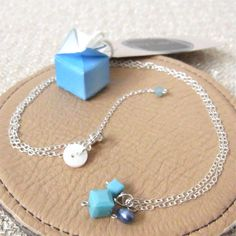 Dainty Necklace with Turquoise Cubes | Layering Necklace | Contained in a Miniature Origami Box | Origami Necklace | Origami Gift Box by ByLawLondon on Etsy https://www.etsy.com/uk/listing/207136250/dainty-necklace-with-turquoise-cubes