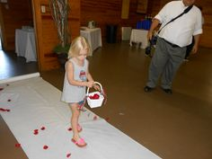 Goddaughter of the bride makes a practice run of her flower girl duties for the ceremony.