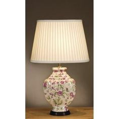 Pink Carnations ceramic table lamp with delicate pink flowers and green leaves depicted on a cream vase shaped base. A traditional design Chinese influenced lamp from the Oriental range that forms part of our Empire Table Lamp Collection. This collection showcases high quality designer lamps that exude style and class. It is the attention to detail that sets these lamps apart and they are held in high regard by interior designers and retailers alike. This lamp has a delicate feminine feel…