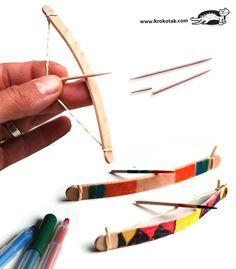 Mini arcs (bâtonnets à glace, élastique et cure dent pour les flèches). Attention ! Tirer sur des cibles !