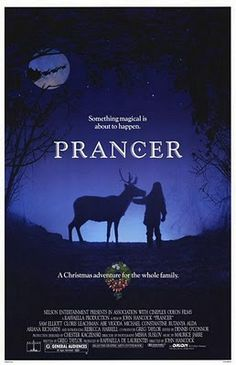 """1989's """"Prancer"""" is the story of 8 year old Jessica, the daughter of an impoverished apple farmer, who still believes in Santa Claus. So when she comes across a reindeer with an injured leg, she assumes that it is Prancer, who had fallen from a Christmas display in town. She hides the reindeer in her barn and feeds it cookies, until she can return it to Santa. Her father finds the reindeer an decides to sell it to the butcher, who wants it not for venison chops, but as an advertising…"""