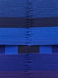 Ultramarine blue. Intertwined.  Using 40 000 meters of Hallingdal yarn, London based designer Simon Hasan created 1000 meters of Hallingdal braided rope.  Part of Hallingdal 65 in Milan 2012.