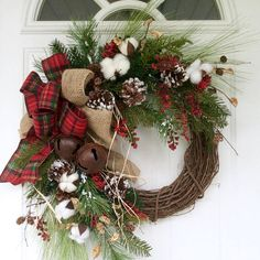 This rustic evergreen wreath is a beautiful way to celebrate the season without all the fuss. Realistic Douglas fir, scotch pine and eucalyptus are joined by cotton bolls, frosty pine cones and twigs and bright red berries to create a homespun design that will be at home anywhere. A